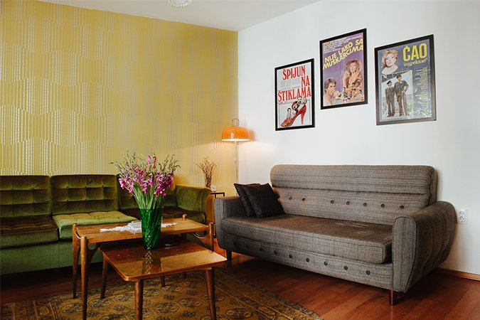 "The lounge also features bits of cinematic history, with a focus on the kitchy comedies of the 1980s that introduced queer themes to mainstream movies. ""Working on Yugodom was not only a designer process, but also a historical research and curatorial creation,"" says Milakovic.  Photo 4 of 5 in This Vacation Rental is a Living Museum of Midcentury Eastern European Design"
