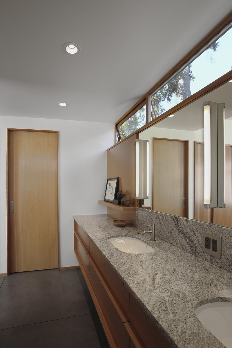 Bath Room Just off the bedroom, a restrained bathroom combines Duravit D-code sinks with Techno by Cifial faucets and a Toto Aquia toilet.  Photo 7 of 11 in Seattle Home Carefully Blocks Out Neighbors, While Celebrating Natural Surroundings