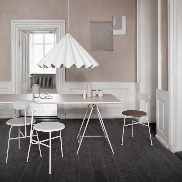 Reminiscent of a twirling skirt, the Dancing Pendant Light by Iskos-Berlin for Menu is a playful twist on sartorial details. Its oversized proportions make for an intimate setting or focal point in the dining room. The pleated, pyramidal shade is also made of polyester felt, which also absorbs sound.