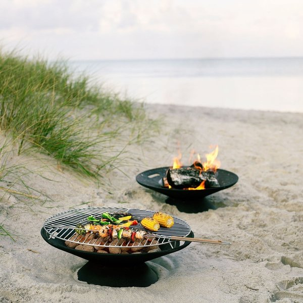 The Helios Fire Bowl Set from Skagerak is a portable outdoor fireplace that is ideal for a back patio. It can be used as a fire pit, or with the Helios Steel Grille and some charcoal to create an outdoor grill for hotdogs, vegetables, or shish kebabs.