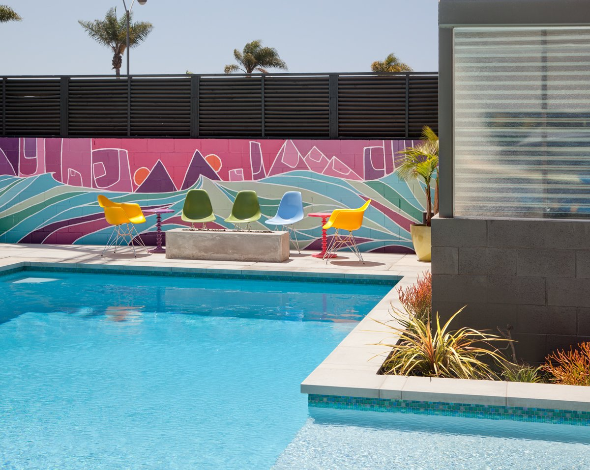 One of the client's main requests for the home was a large pool to replace the existing asphalt backyard. Artist Nate Schnell painted a second mural in this area to add color and energy.  Photo 6 of 10 in A Dull Stucco Home Becomes a Modern California Oasis