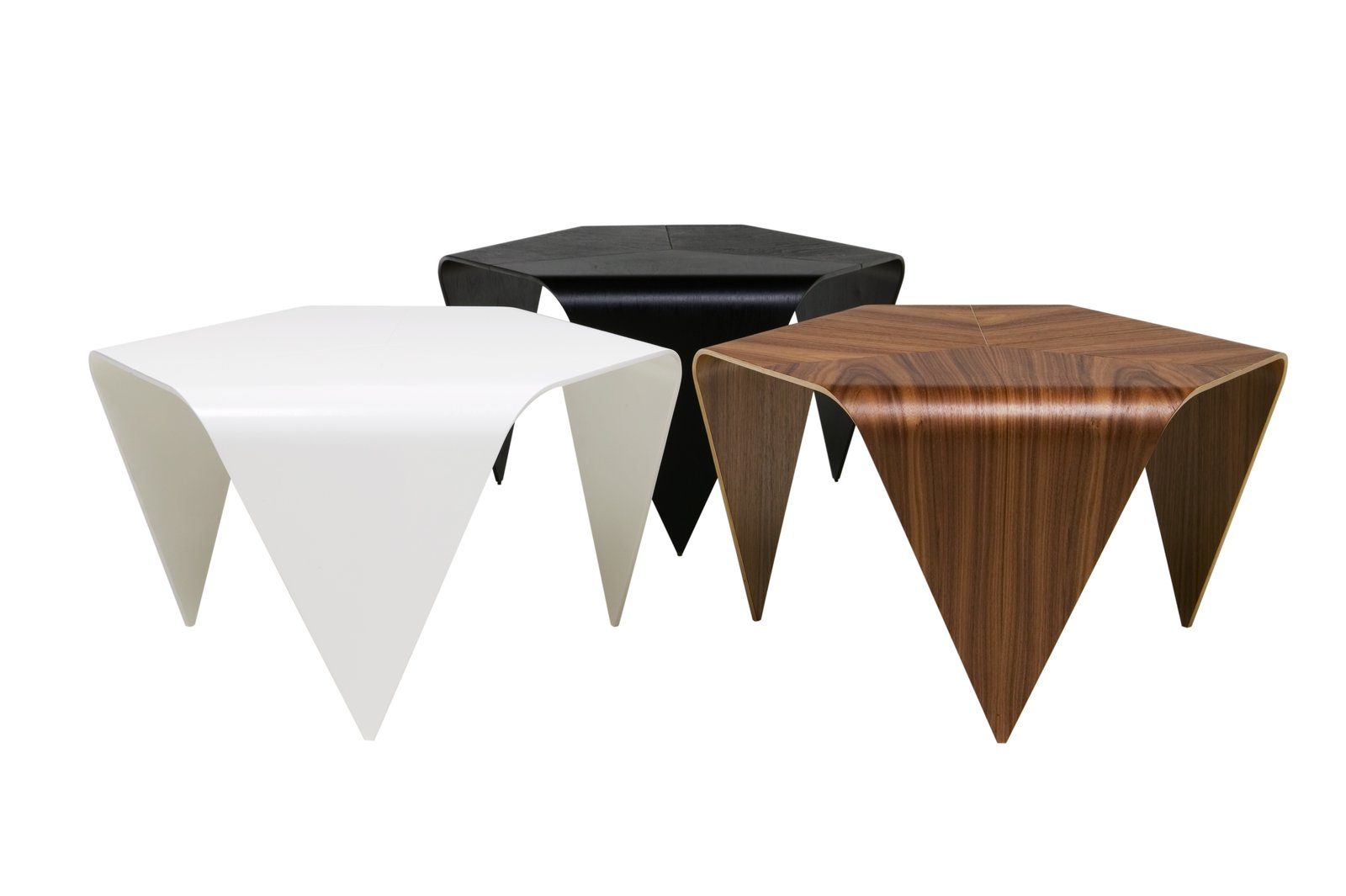 Tapiovarra's 1954 Trienna coffee table is made of three pieces smoothly conjoined to form one surface with six rounded edges. The tables, which are made of formed birch wood with surface veneer in walnut, are manufactured in Finland by Artek.  100+ Best Modern Seating Designs from Aalto Isn't the Only Finnish Modernist: Meet Ilmari Tapiovaara
