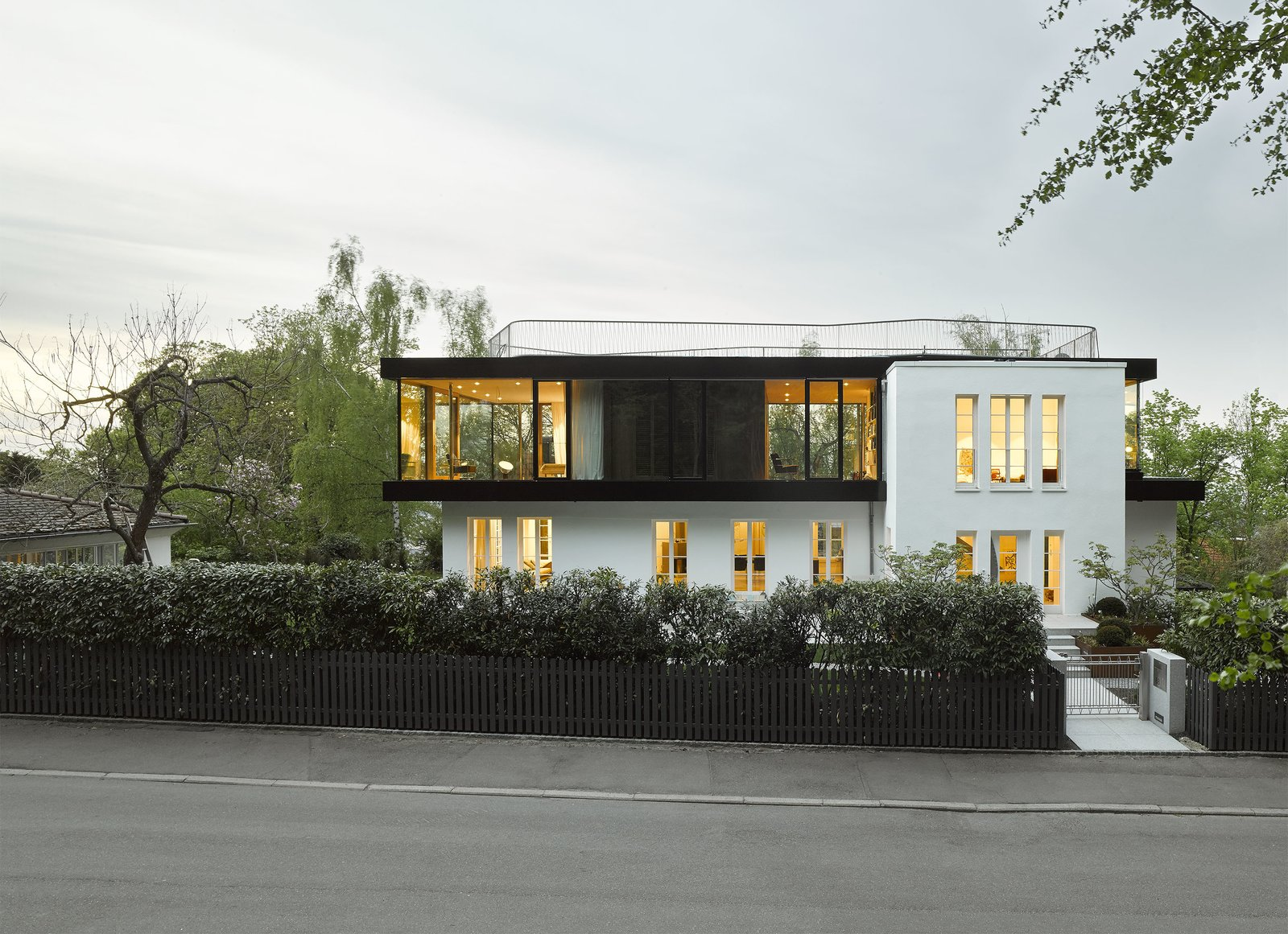 Behnisch Architekten remodeled the entire 1930s home, yet reserved their most transformative changes for the second-level. The structure's traditional pitched-roof was replaced with a flat, modern one.  Exterior Renovation from An Uninspired Home in Germany Gets a Bright, Eco-Friendly Update