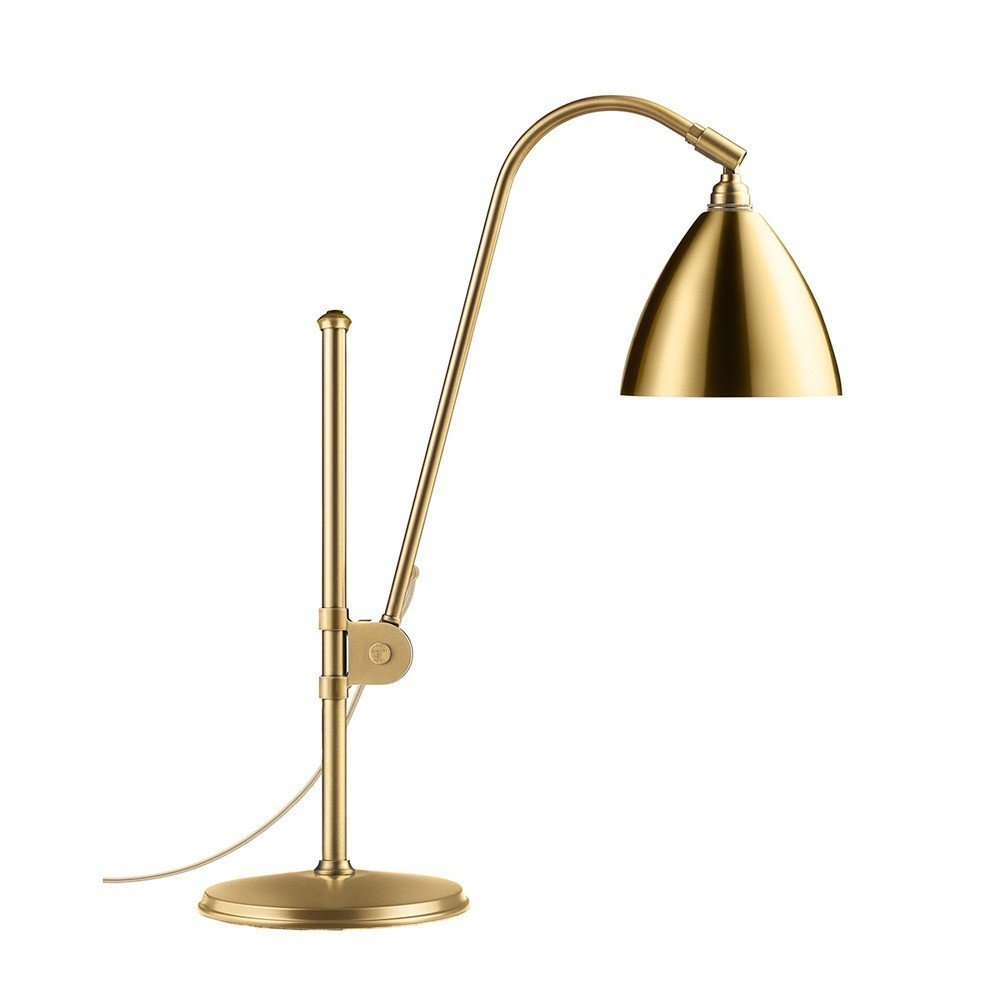 "The Bestlite series from Gubi has been in continuous production since the 1930s, proving that its silhouette and construction are timeless elements that complement both traditional and modern interiors. This all-brass version of the classic Bestlite BL1 Table Lamp is an undeniable statement maker. It is also available in brass with powder-coated shades and chrome options.  Search ""classic danish nesting tables set"" from Modern Brass Lights We Love"