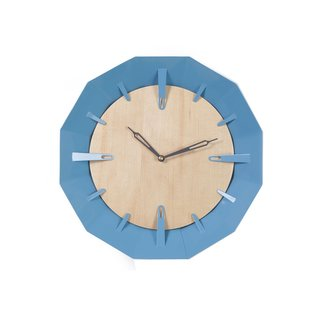 ThisCaldera Wall Clock created by Schmitt Design features a maple face with a steel blue geometric design.