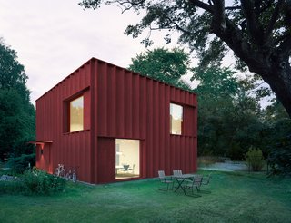 Driven by data found on the site, the architects decided to merge the traditional red wooden cottage archetype with the modern box home.