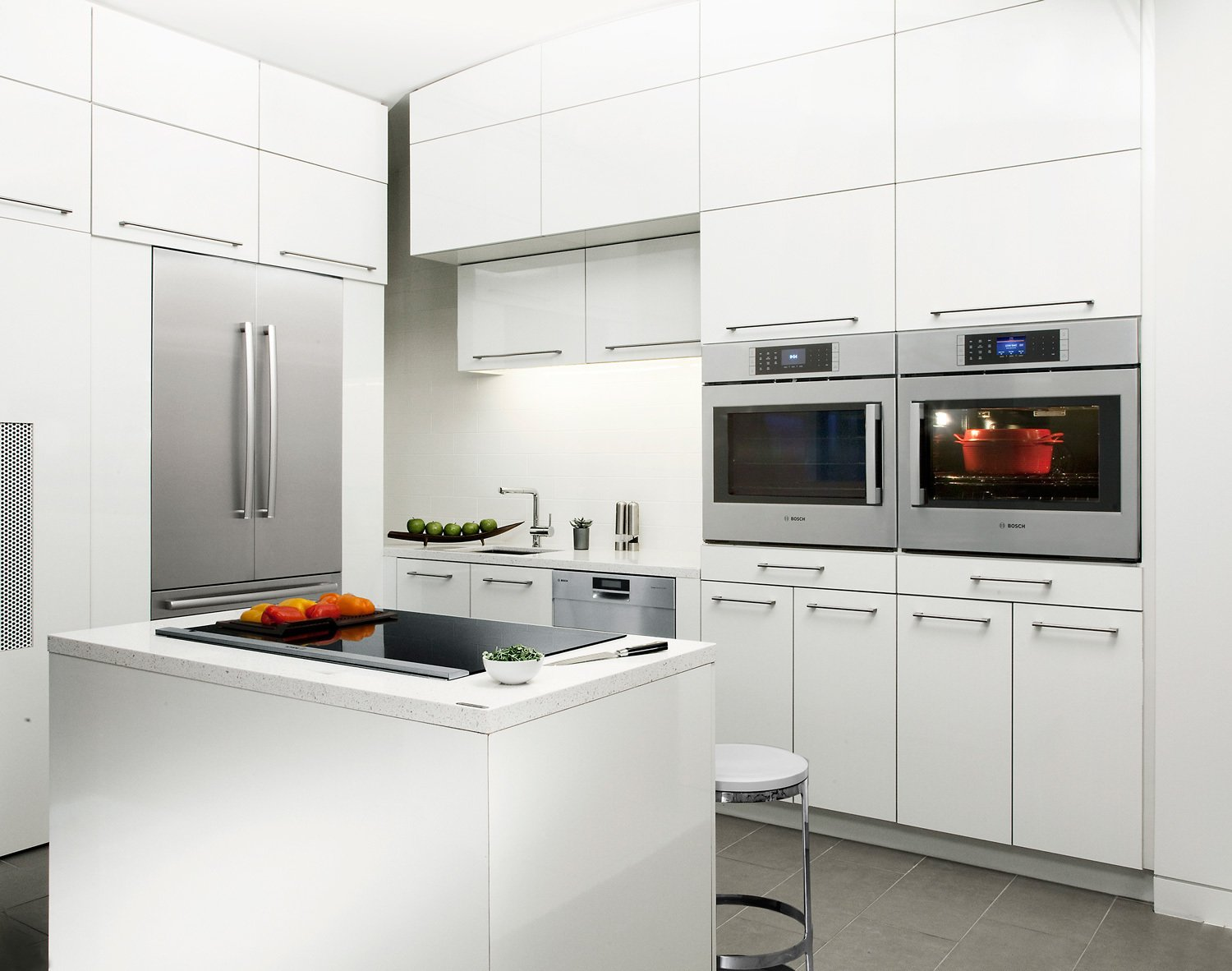 This rational European ethos motivates Bosch appliances' design down to the most minute details. For meals that require large and small pots, the FlexInduction feature on Bosch Benchmark induction cooktops combines two distinct cooking zones into one contiguous area, providing total fluidity of movement.  Kitchen from Modern Kitchen