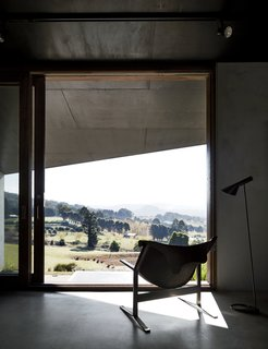 """A Clement Meadmore Sling chair provides a favorite vantage point for sipping coffee while looking out at Hanging Rock. """"It's always hard to leave and return to the city,"""" Titania says."""