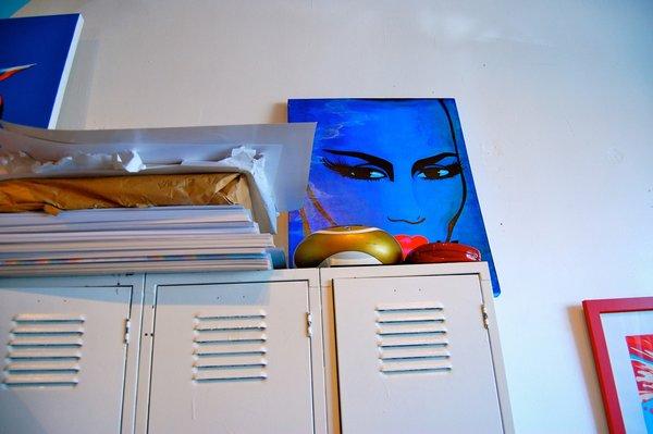 A portrait of Grace Jones, by Niagra, sits on top of a locker bank.
