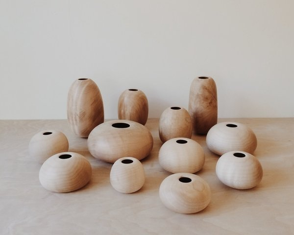 """Song exhibited these wood vessels at Heath Ceramics. """"I first started with the very basic form, which is a bowl,"""" Song says. """"While it may seem pretty simple, I feel that it took me months to understand the technical aspects of working with wood and the lathe. After a year of turning, 500 or so bowls and pieces later, I am bit more comfortable but I am many years away from fully understanding the craft."""""""
