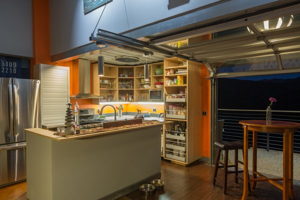 In the open-plan kitchen, a garage door can be retracted to take advantage of the balmy California climate and bring the outdoors in. Mike's wife, Shawn, appreciates the home's proximity to hiking trails.