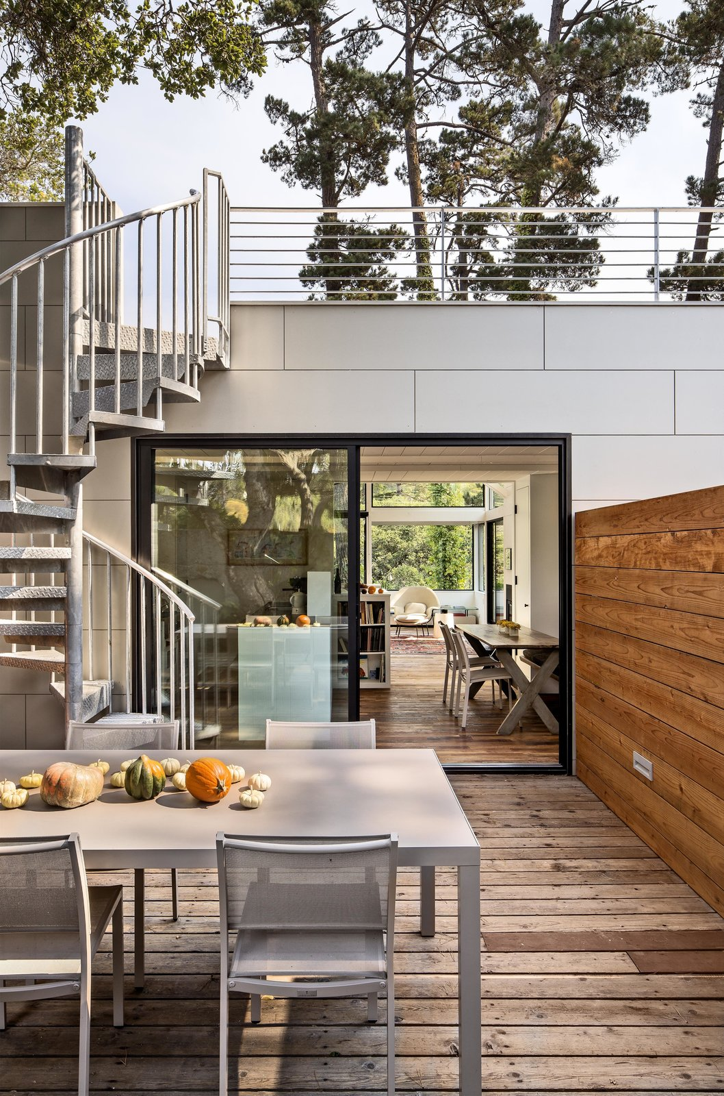 """The house is set on a forested hill, which means the backyard—though scenic—is too steep to enjoy. It's also perpetually shady. Schicketanz wanted somewhere she could soak in the sun, so she added a roof deck. """"It's really the only usable, large outdoor space I have,"""" she says.  Photo 1 of 10 in Bright Renovation of a 1970s Big Sur Home from Torres House"""