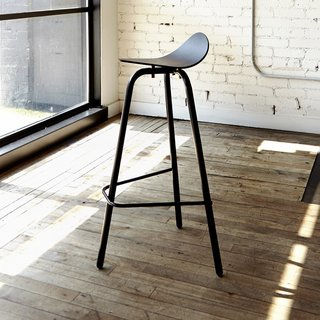 The Biker Stool from Castor is an innovative and sculptural seat that is available at both chair and bar heights. Inspired by the geometry of a motorcycle seat, the stool's seat features a curved and angled silhouette.