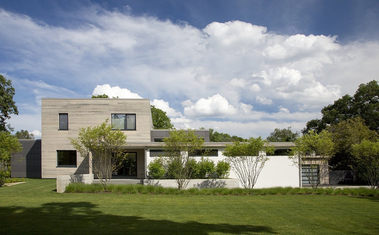 Exterior, House Building Type, and Wood Siding Material With its green features, durable materials, and clean-lined minimalism, the house represents the new generation of building for its mostly colonial neighborhood.  A Modern Green Home in a Historic Colonial Town by Allie Weiss