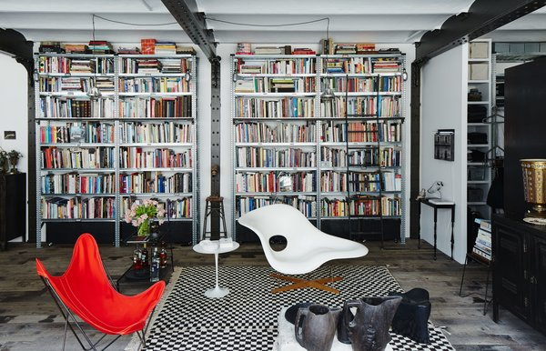 In the living area of Daniel Rozensztroch's Paris apartment, an Eames La Chaise and a butterfly chair complement a Moroccan Berber rug.
