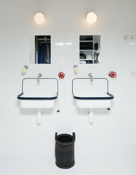 Boffi faucets join sinks from Labour and Wait in the bathroom.