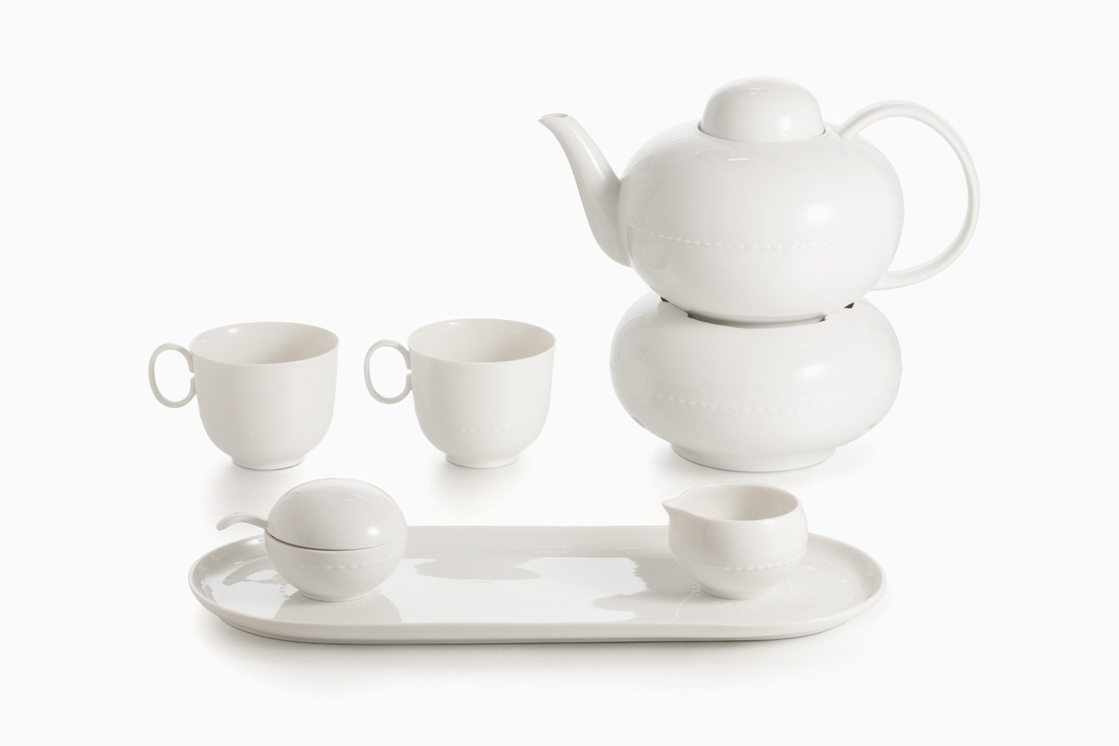 Haute Couture Tea Service (2001) by Konstantin Grcic, estimated at $1,800–$2,500. Designed by Konstantin Grcic, the Haute Couture Tea Service focuses on an aspect of the method of porcelain production. He uses the seams produced by the process of demolding to decorate his plain white tea service. A finely dotted line in the shape of a seam borders the individual pieces as a relief.  Photo 8 of 10 in Design Guru Murray Moss Launches an Auction With Paddle8
