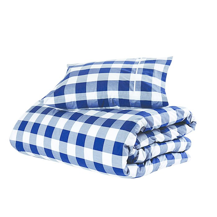 What is your everyday bedding?  Original Duvet Cover in Blue Check by Hästens, $260.  Photo 3 of 6 in Ask the Expert: Gift-Buying Tips from Byron Peart of Want Les Essentiels de la Vie