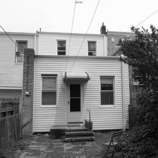 The home's rear exterior before the renovation.