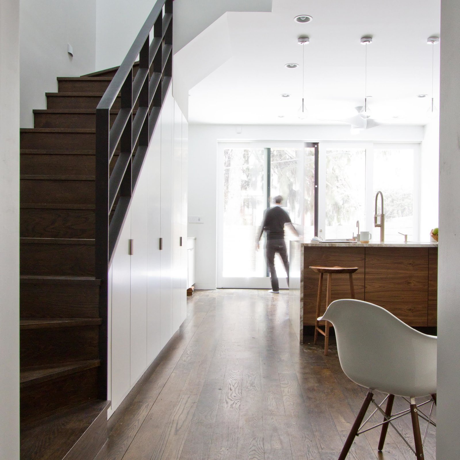The biggest challenge of the project was designing a space that could be easily converted from a 2-family to a 1-family. Thoughtful planning and inventive storage systems were thus key to the success of the renovation.  Revitalization by Caroline Wallis