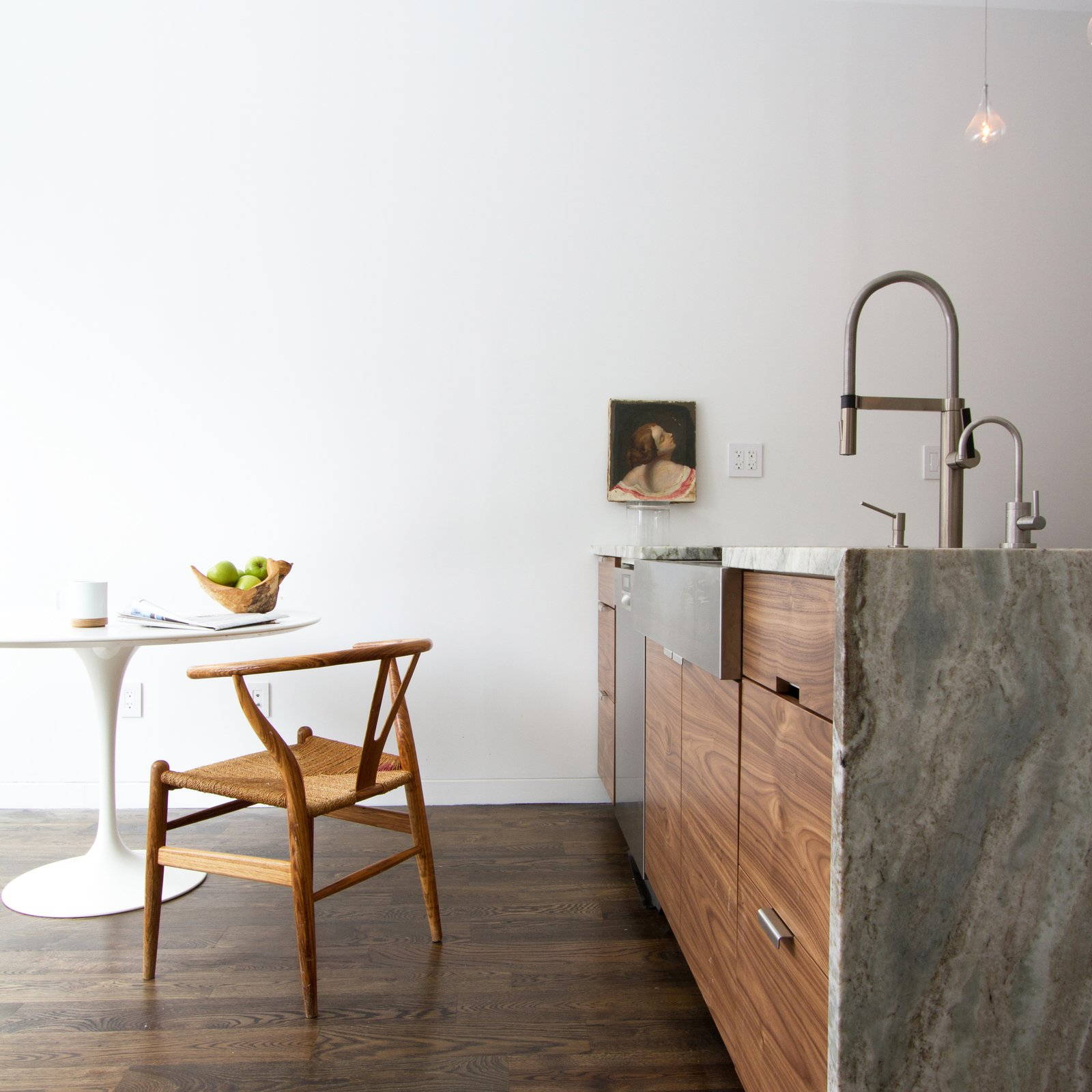 Earthy details meet minimalist angularity in the kitchen. Consentino countertops play to both styles.  Revitalization by Caroline Wallis