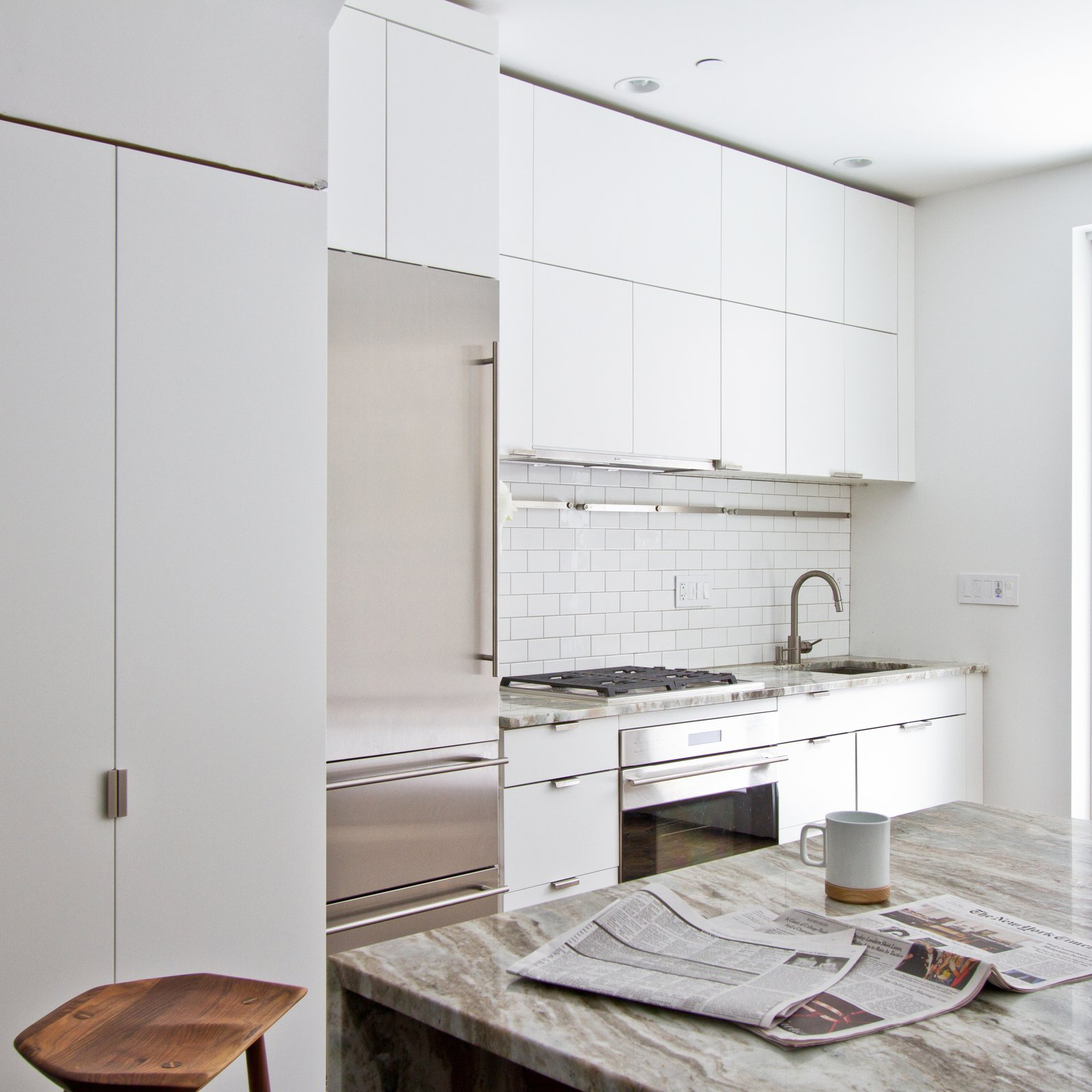 The white interior, in addition to presenting the home as a potential blank canvas, helps reflect ample natural light.  Revitalization by Caroline Wallis