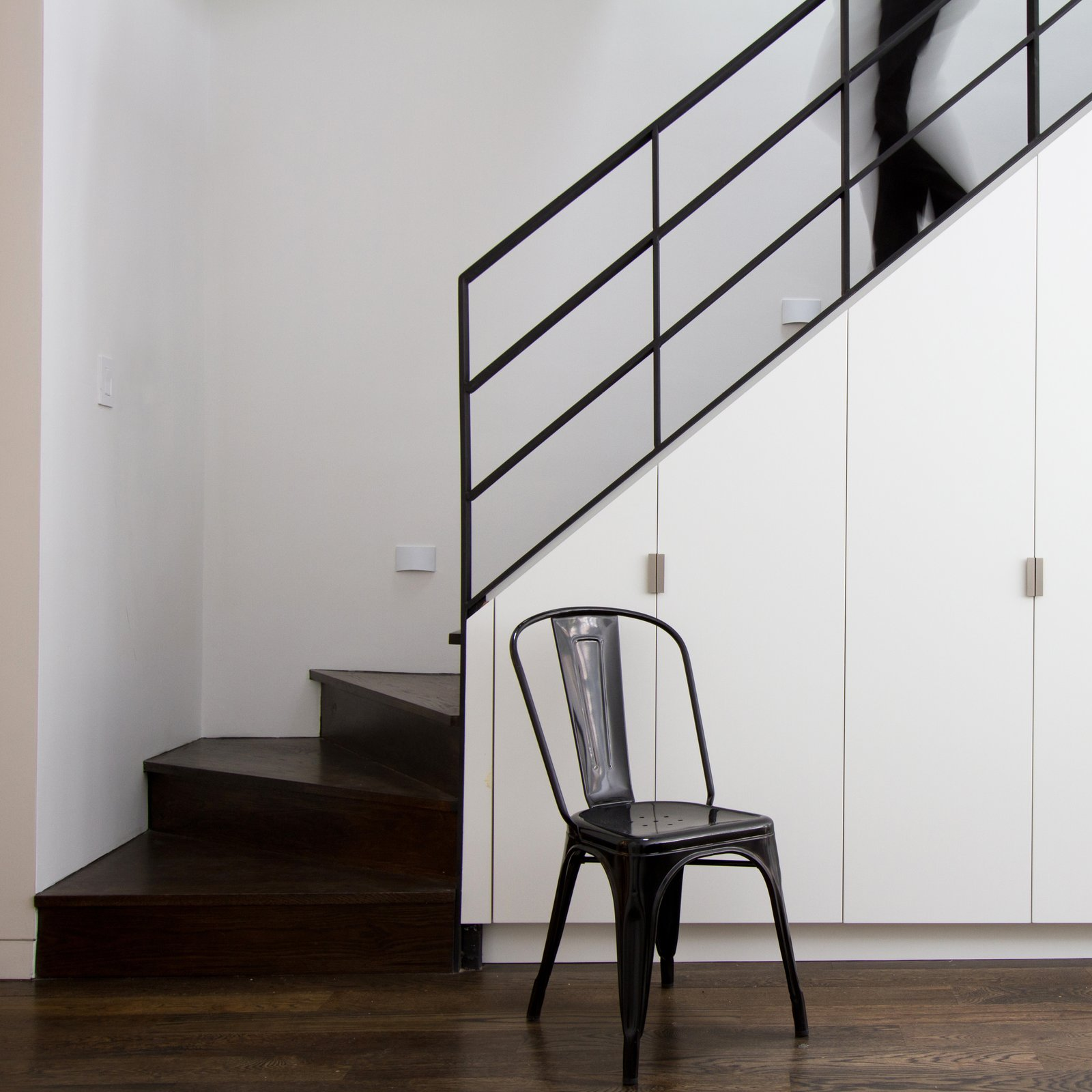 "Staircase, Wood Tread, and Metal Railing ""Elegant material choices, subtle detailing, and thoughtful spatial sensibilities belie the building's intelligent space planning,"" says Aniket Shahane of OA.  190+ Best Modern Staircase Ideas from Revitalization"