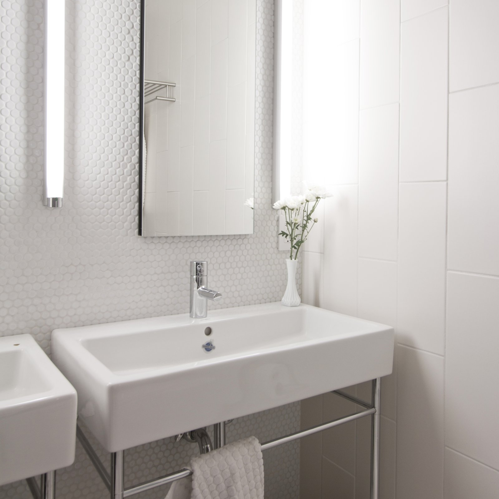 The main bathroom experiments with varying textured tiles, and is equipped with Duravit, American Stand, Toto and Kohler fixtures.  Revitalization by Caroline Wallis