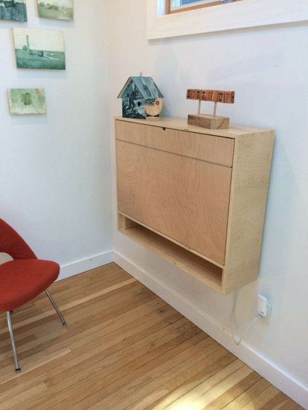 """""""We used magnets to hold everything closed to keep things looking clean. The first small fold is important, as it acts as a spacer to keep the top of the desk level as it sits on the fold-out supports underneath."""""""