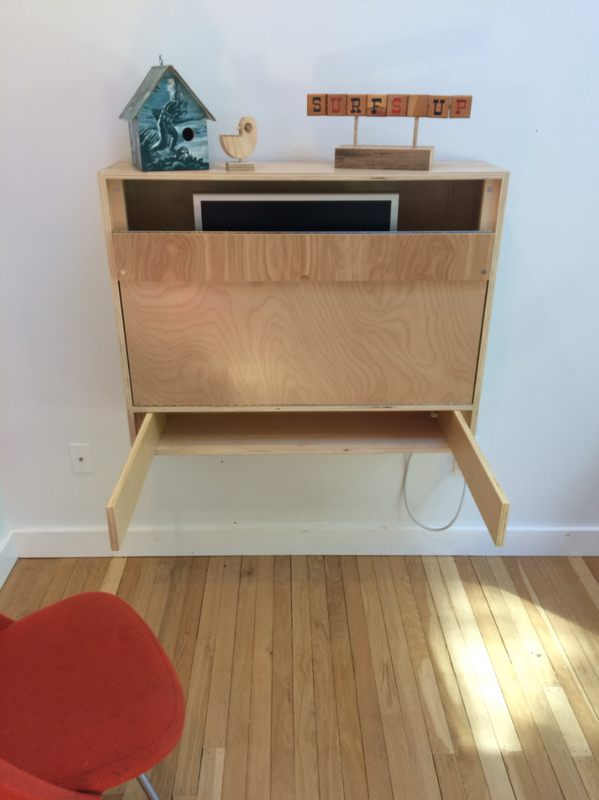 """""""The supports underneath the desktop fold out from the bottom section of the desk. We thought this gave a bit more support along the whole length of the desktop, rather than just at two points which is what happens when using the more common cable support system to hold up the desktop."""""""