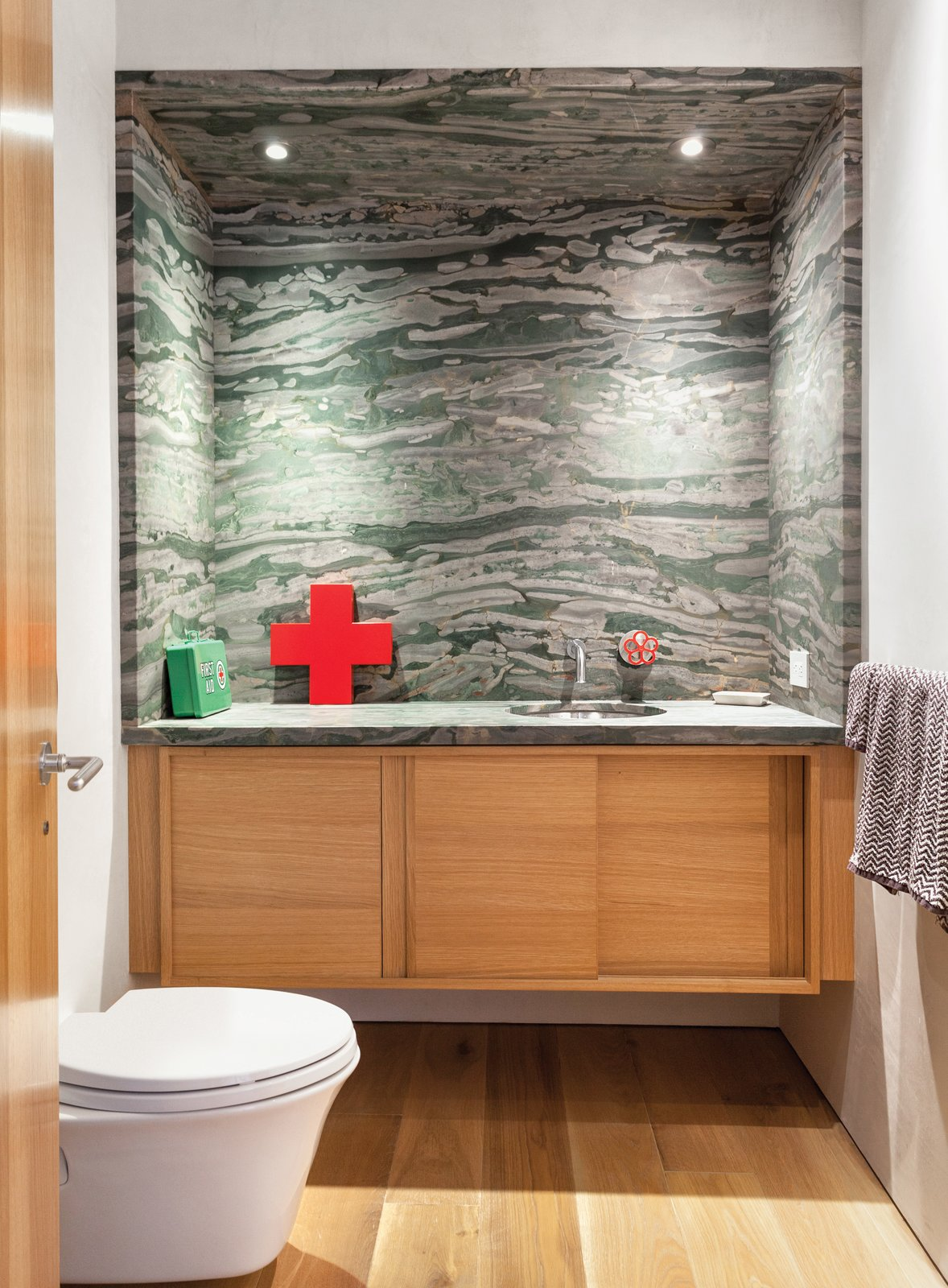 Severns put in a glass-block wall to separate the office from the guest bedroom, and created brand-new bathrooms.  Parker Willis House by Erika Heet