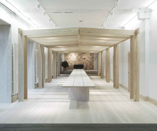The main showroom and event space is defined by a 50-foot-long wood table, made from three, solid Douglas fir planks. Dinesen's signature, clean floors cover the entire showroom.