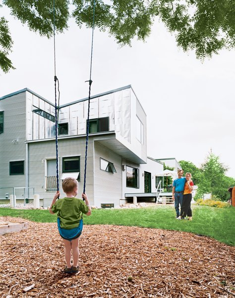 The eco-friendly Ann Arbor home of Tom McMurtrie, Genia Service, and their son Gary features a brilliant reflective steel cladding.