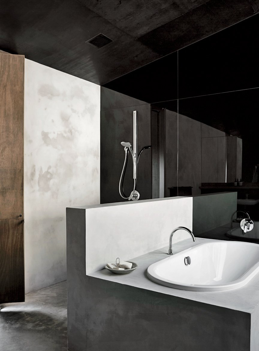 Bath Room, Concrete Counter, Drop In Tub, Concrete Wall, Open Shower, and Concrete Floor The en suite tub is by Kaldewei, the mixer is by Tonic, and the spout is by Sussex Taps.  Photo 5 of 10 in Richly Furnished Home Frames Striking Landscape Views