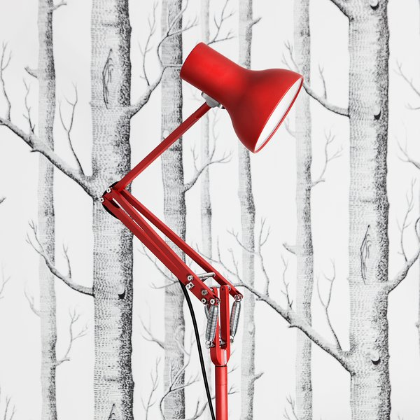 The Type 75 Mini Floor Lamp is a sophisticated floor light that is designed with small spaces in mind. The lamp is defined by its classic Anglepoise looks—it features clean lines and a simple shade—and a thin profile. Shown here in bright red, the lamp is also available in other colors including black, white, grey, and light blue.