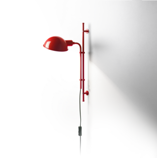 The Funiculí Wall Lamp is an update of a lamp designed in 1979 by Spanish designer Lluís Porqueras, who is renowned for the absolute simplicity of his designs. The name Funiculí comes from the concept of funicular action—moving up and down. Shown in red, the lamp is also available in neutral colors. It is also available as a floor lamp and table lamp.