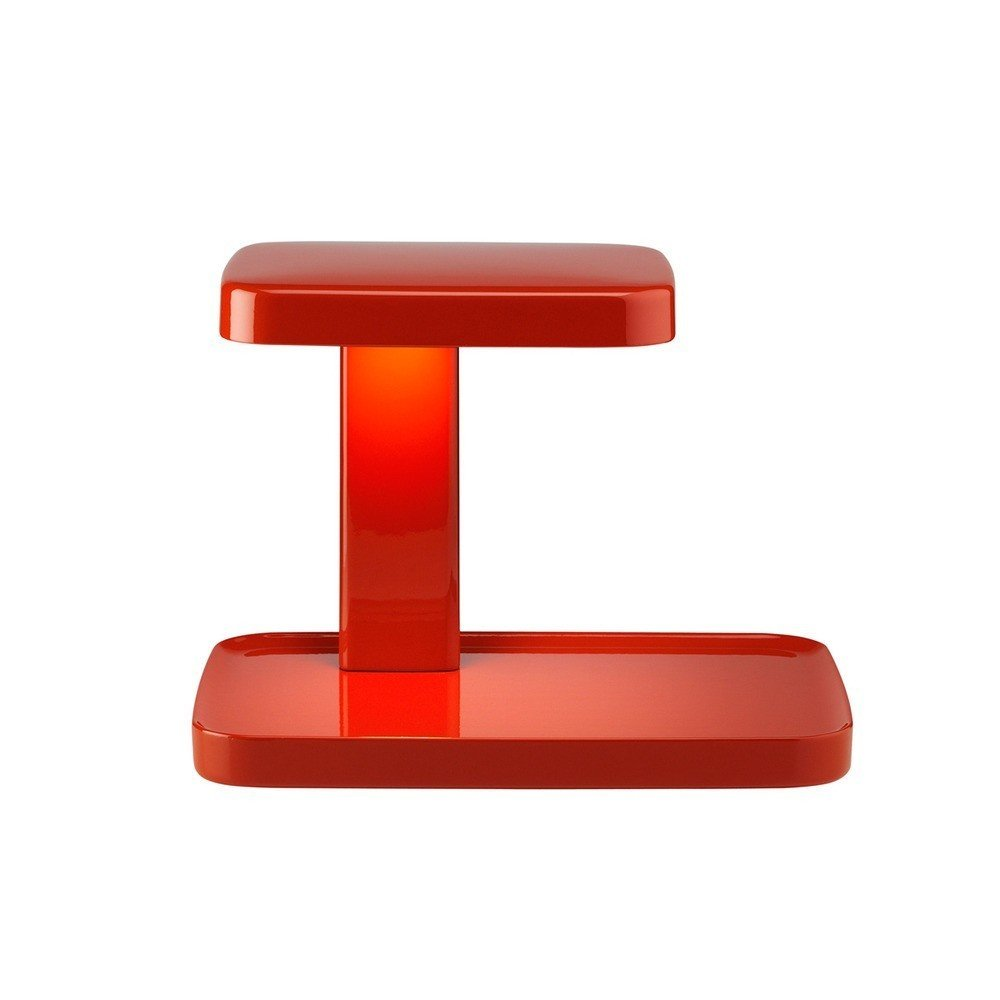"""Designed by innovators Ronan and Erwan Bouroullec for FLOS, the Piani Table Lamp offers stylish and modern asymmetry for the home or work environment. Made of injection printed ABS, this unique lamp provides both direct and ambient light with energy-efficient LED technology.  Search """"f k a table lamp"""" from Red Light District: Explore Ten Lamps in the Boldest Color"""