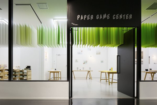 Paper Game Center (2013)  A pop-up installation for the Shinjuku Creators Festa in Tokyo invited visitors to play a number of designer-created games using paper from Takeo. Moureaux suspended 840 pieces of paper in a spectrum of 100 colors.