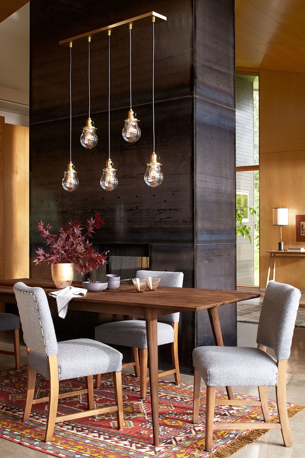Made from salvaged wood, these chairs by Revive Designs are upholstered in Pendleton wool.  Photo 4 of 7 in Classic Modernist House in Portland Inspires a Lighting and Furniture Line