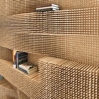 "This one's quite literally a ""pegboard"" so we had to throw it in. An undulating wall made from over 40,000 dowels adds a dose of awe to a Massachusetts loft."