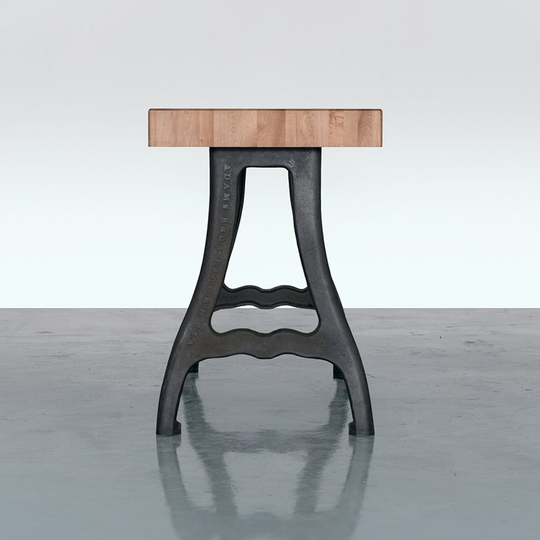 Fern & Roby's furniture combines modern finishes with a reverence for the history of American industry. The base of this kitchen island is a reproduction of legs from a salvaged 19th-century kick press machine, which the designers had cast at OK Foundry, a fourth-generation owned family business located four blocks from the Tektonics studio.  Made in America: An Inside Look at a Virginia Furniture Workshop by Heather Corcoran