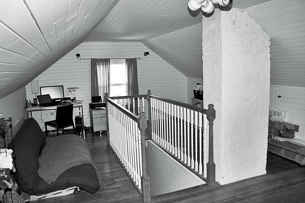 Before the renovation, the attic was a cramped, cluttered space—a feeling reinforced by the presence of a brick chimney that was later demolished and the relatively low 7.2-foot ceilings.  Photo 7 of 7 in A Musty Attic is Transformed Into a Luminous Loft