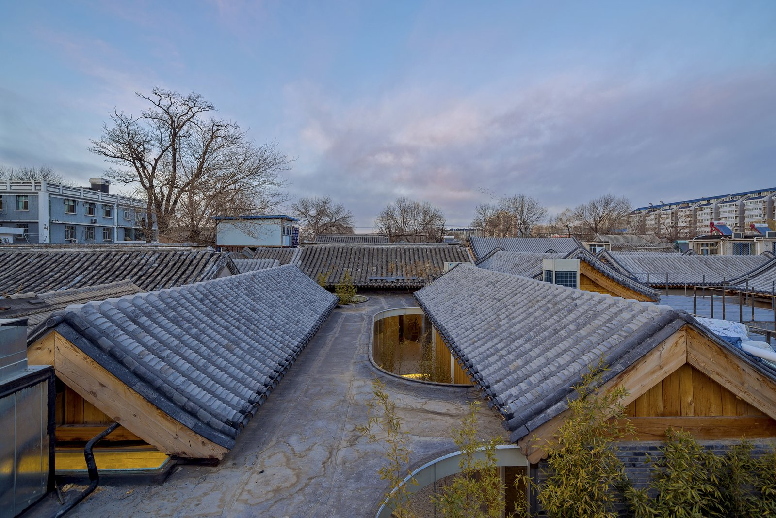 A second view of the tea house's roof with pitched wooden supports visible.  Photo 7 of 7 in A Historic Beijing Structure Gets a Modern Makeover