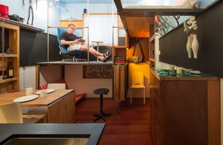 DIY touches define this three-tiered, 182-square-foot studio, belonging to artist and engineer Steve Sauer. Tables, shelving, and benches are made of wood recycled from IKEA products.   Copyright Andrew Pogue Photography.