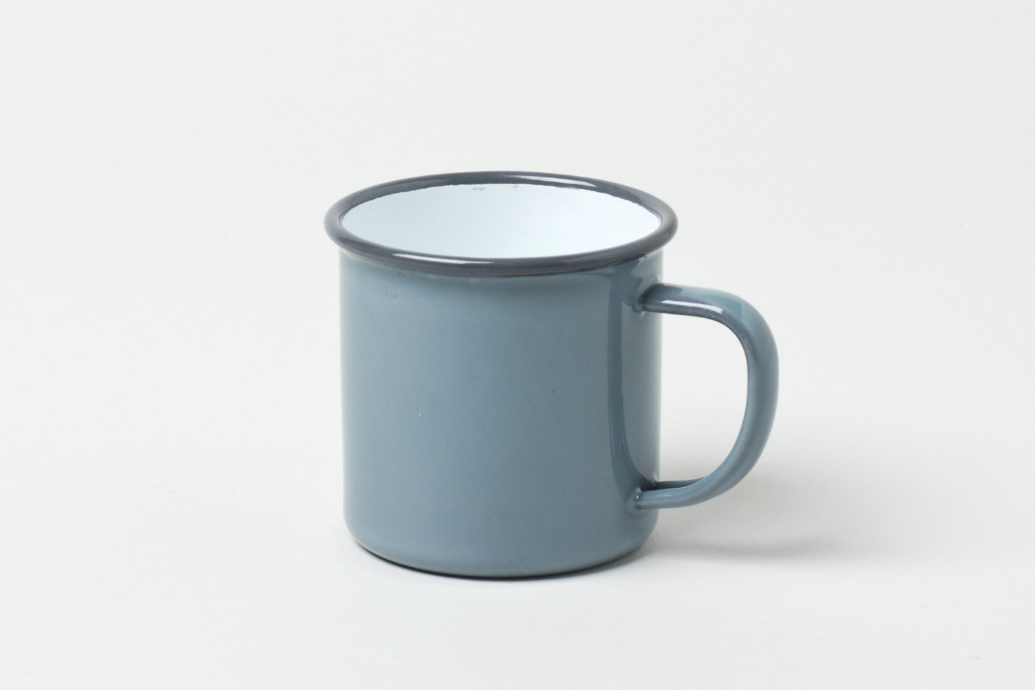 """This classic Falcon Enamelware Mug is safe for even your hottest cups of coffee and cocoa. Although it is extremely durable, the mug is not bulky. The expertly crafted enamelware is thin, and the simple handle appears delicate, while remaining stable and strong.  Search """"jansen co my mug espresso saucer"""" from Get Ready for Fall with 8 of Our Favorite Designs"""