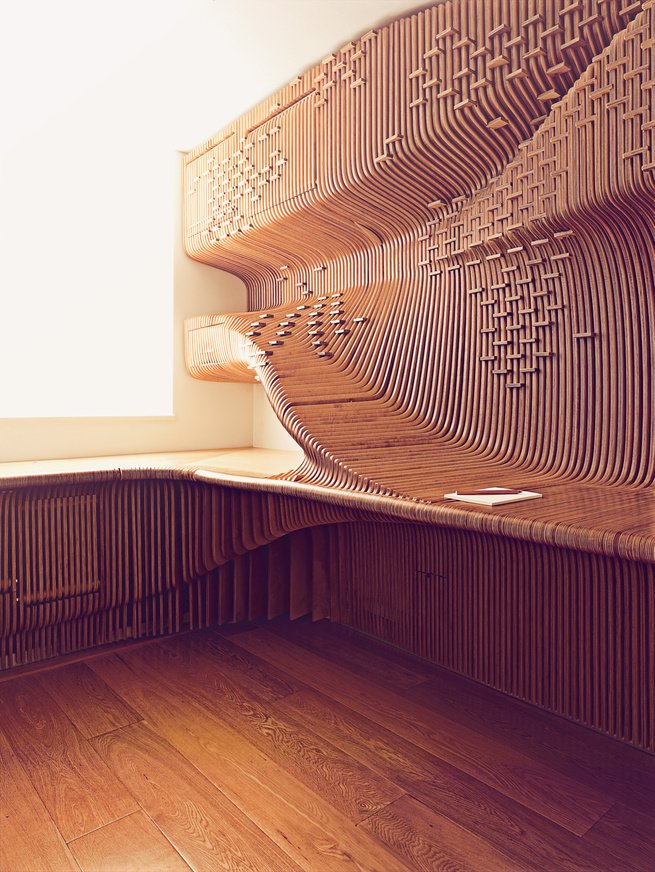 When a London homeowner contacted architect Alvin Huang about building him a sleek and sculptural built-in desk, Huang and his team got creative, hanging sheets of fabricated milled birch to produce a sinuous three-dimensional form. Look closely and you can see the five hidden cabinets that conceal files, books, a phone, and a paper shredder. Additional inset horizontal spacers form an abstract world map and double as a means of holding the boards in place.  Ingenious Built-Ins  by William Harrison