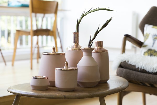 Hend Krichen is the producer of these vases and containers, made of Tunisian ceramic with copper details.