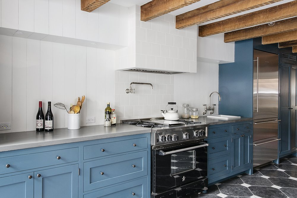 Kitchen, Colorful, Ceramic Tile, Refrigerator, Ceramic Tile, Range, Vessel, and Drop In The lovely cornflower-blue kitchen cabinets in this Brooklyn, New York, home by Elizabeth Roberts Architecture & Design were professionally painted.  Kitchen Refrigerator Vessel Photos from A Neglected Brooklyn Townhouse Becomes a Home That's Primed for Entertaining