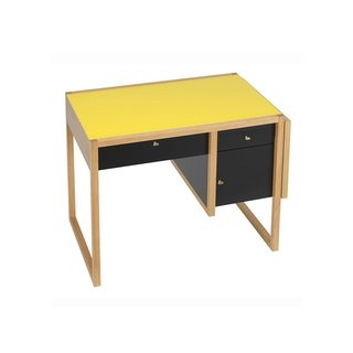 A modern reconstruction of Josef Albers original 1927 design, this writing desk was built for the Moellenhoff family. Although their home was destroyed in the war, this piece, along with Albers' famous nesting tables, was saved and brought to the United States prior to the outbreak of World War II. Nearly an exact copy of the original desk, the writing desk is made of solid oak with a yellow lacquered glass top, black lacquered drawer fronts, brass hardware, and an oak side panel that can be raised to create a larger work space.