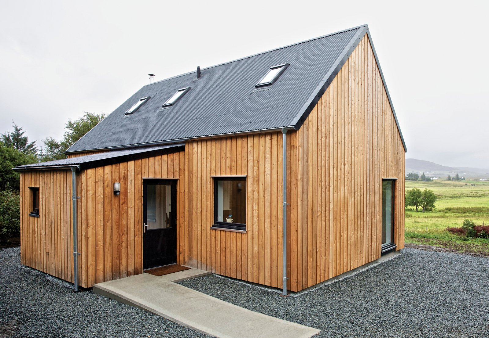 """""""It's a beautiful part of the world,"""" says architect Alan Dickson about Scotland's Isle of Skye. """"The downside of that beauty is that land is expensive and very difficult for young people to afford, so they're leaving the island."""" In 2010, Dickson, of the Skye-based firm Rural Design, and local builder James MacQueen came up with a solution: a small timber-frame prefab design called the R.House, which can be constructed quickly and tucked onto less expensive lots that don't appeal to well-heeled holiday homeowners.  Photo by Marcus McAdam.  Sourcing Guide for Modern Prefab Companies in Europe by Kelsey Keith"""